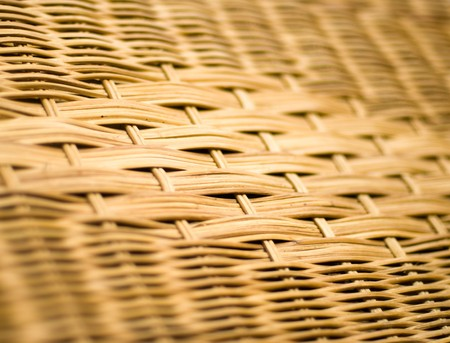 A close up of a woven rattan pattern photo