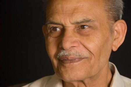 A portrait of a senior Indian man