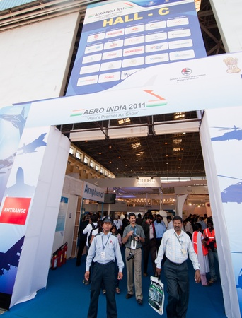 aero: BANGALORE, INDIA - FEBRUARY 11: Visitors leave a hall at the Aero Show on February 11 in Bangalore, India. The Aero Show is one of the largest in Asia attracting 670 exhibitors.