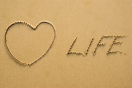 Love Life - written on a sandy beach