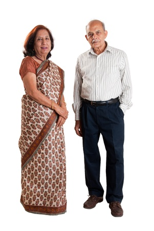 A senior Indian / Asian couple standing - isolated on white photo