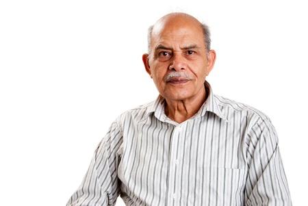 A senior Indian / Asian man - isolated on white photo