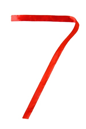 seven years: Number seven written with a red ribbon Stock Photo