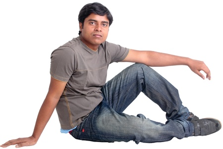 A young Indian man sitting on the floor - isolated on white Stock Photo - 13889231