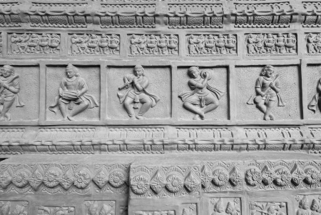stone work: Hindu sculpted background with dancing figurines - in mono