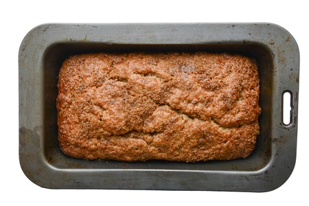 Delicious banana bread in a baking dish - isolated on white photo