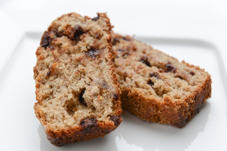 Slices of delicious banana bread on a white plate
