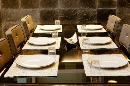 Dinner table with place settings photo