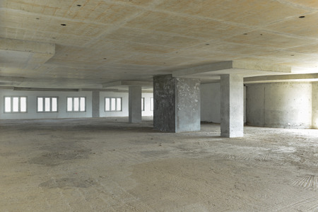 abandoned warehouse: An empty shell of building or carpark before fit outs or interiors - construction industry