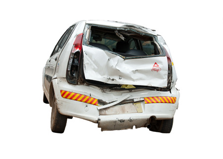 scrap: An isolated image of a crashed, wrecked and totalled white hatchback. Insurance claims pending!