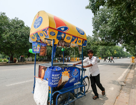 New Delhi, Aug 15, 2018: An ice cream vendor pushes his Cream Bell cart on the streets of New Delhi. Most people in India are employed in service related jobs