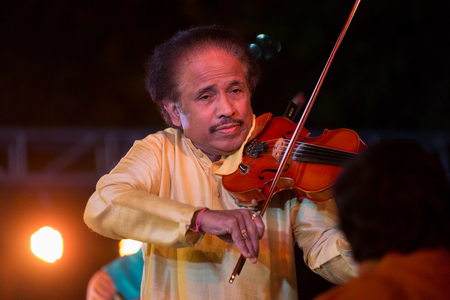 Bangalore, India - February 10, 2018: Indian violinist, composer and conductor Dr L Subramaniam plays the violin as he performs onstage in Bangalore, India on February 10, 2018 에디토리얼
