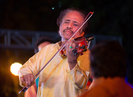 Bangalore, India - February 10, 2018: Indian violinist, composer and conductor Dr L Subramaniam plays the violin as he performs onstage in Bangalore, India on February 10, 2018