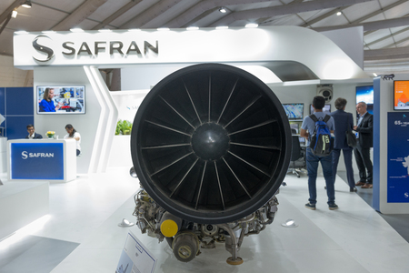 Bengaluru, India - February 22, 2019: Visitors at the Safran stall at the Aero India 2019 exhibition in Bangalore, India. Aero India is a biennial air show and aviation exhibition and one of the largest in Asia. Safran is a French aviation and defence com Sajtókép