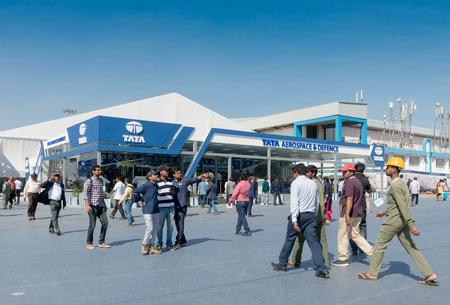 Bengaluru, India - February 22, 2019: Visitors outside the Tata Aerospace stall at the Aero India 2019. Aero India is a biennial air show and aviation exhibition.