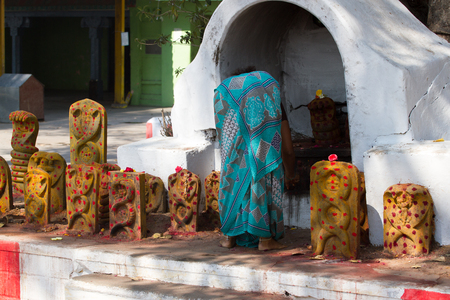 shakti: Group of yellow tombs with red dots in Shiva temple, Kanchipuram
