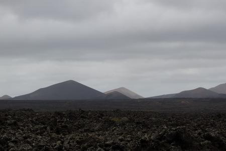 scoria: Desert arid stone volcanic landscape in Lanzarote, Canary Islands Stock Photo
