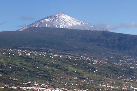 View of La Orotava valley and snowcapped volcano Teide. Panorama Stock Photo