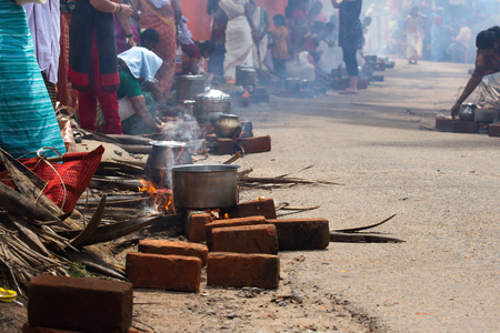 kovalam: KOVALAM, KERALA, INDIA, April 1, 2015: Some women devotees participate in Pongala ceremony where boiled rice made in clay pots is offered to the god