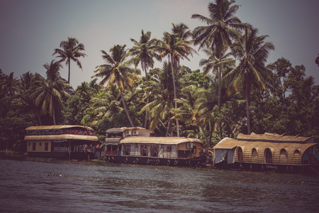 alappuzha: Allepey, Kerala, India, March 31, 2015: Backwater boats. Channels on the river in the city of Allapuzha