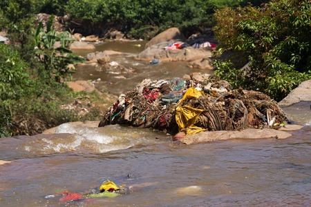 polluted river: Water rubbish pollution with cloth and other floating stuffs, Tamil Nadu, India. Garbage