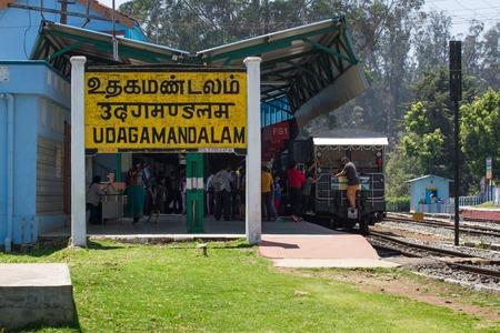 turnout gear: OOTY, TAMIL NADU, INDIA, 22 March 2015 : Nilgiri region. Railroad sign Udagamanadalam written in Tamil official language of Tamilnadu , Hindi and English on a platform of the railway station