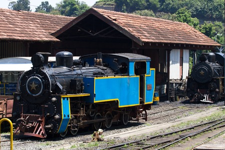 narrowgauge: OOTY, TAMIL NADU, INDIA, 22 March 2015 : Nilgiri mountain railway. Blue train.  Narrow-gauge. Steam locomotive in depot Editorial