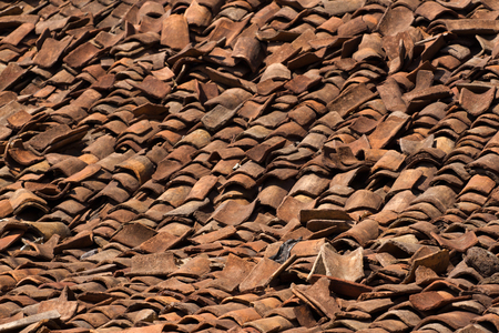 destructed: Background ornament terracotta red ancient tiles. Destructed roof, India, Karnataka