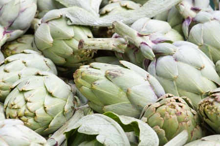 stock photography: Artichoke background. Asparagus family, market stock photography. Local product Stock Photo
