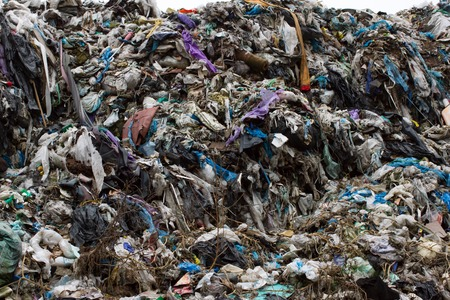 stinks: Pile of plastic bags and other refined petroleum products dumped in landfill. Garbage heap gives infiltrate into groundwater. Waste sorting is required. Lviv city Stock Photo