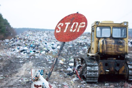 dullness: Red round stop sign, indicating that garbage at this dump has long denied. Landfill works. Lviv waste. Problem of waste disposal.