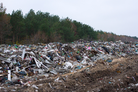 stinks: Landfill in Ukraine, piles of plastic dumped in piles. The roads along inorganic waste jumble, Air, ground pollution