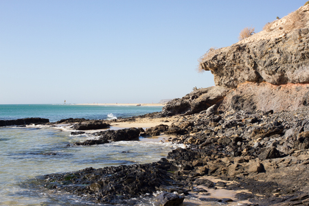 Black rocks of Costa Calma beach. Blue coastline. Playa Barca, Fuerteventura, Canary islands, Spain. Istmo de la pared view Stock Photo