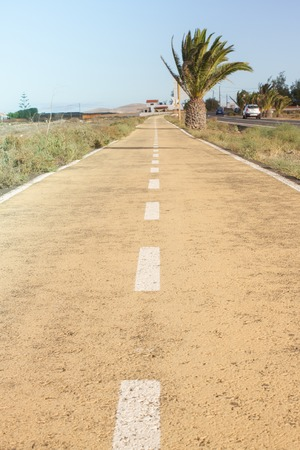 Dirt road in Spain, Canarian islands. Dividing centre line. Bicycle track