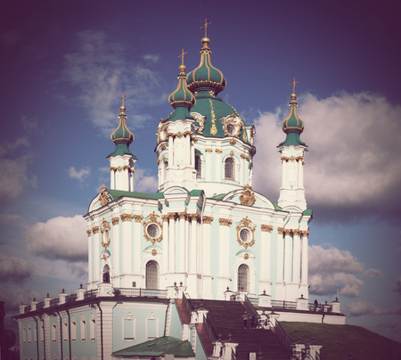 Green baroque St. Andrews Church or the Cathedral of St. Andrew located in city centre, main sightseeing Andriyivskyy Descent in Kiev, Ukraine. Vintage photo.