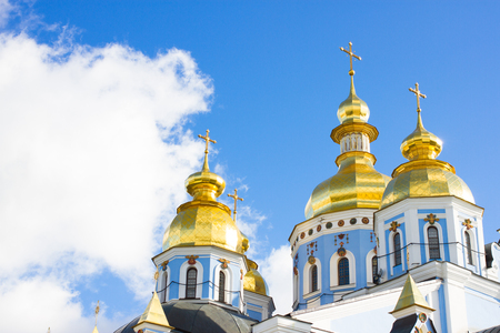 Famous Saint Michael Golden Domed Monastery right photo. Yellow cupola of baroque church on blue sky background. Stock Photo