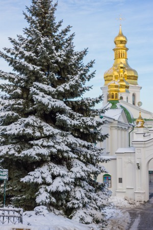 Main entrance, gate to the distant and near caves of the Kyiv-Pechersk Lavra. Famous landmark of Kiev, Ukraine. Wintertime, snow