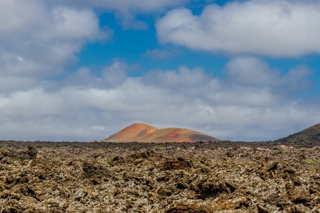 Landscape of Timanfaya National Park in Lanzarote, Canary Islands, Spain. Red and black volcanic mountains. Stock Photo