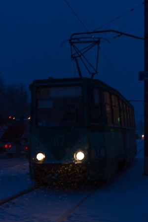 Electric tram in the city of Konotop, Sumy region, Ukraine. Winter night Stock Photo