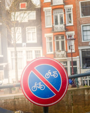Red round sign for bike and motorbike for deny. Walkway in Amsterdam Stock Photo