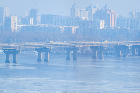 Frozen river. Two parallel bridges. Paton. Kiev. Ukraine. Winter snowy river scenery from Kiev. Ukraine Stock Photo