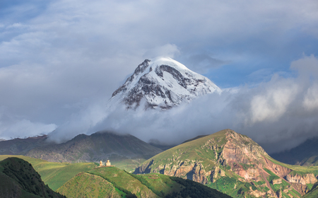 Beautiful panorama view on Kazbek peak mount from the Stepantsminda village in the summer Stock Photo