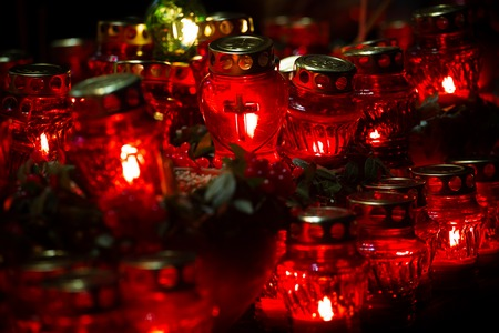 Red candles at night near the holodomor memorial. Honoring the memory of victims of famines in Ukraine. Golodomor