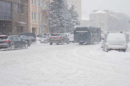The winter city street road in heavy snowy storm.