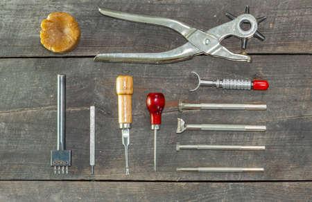 Leather instruments kit. Flat set. second hand leather tooling stamps for handmade leather workshop. Reklamní fotografie