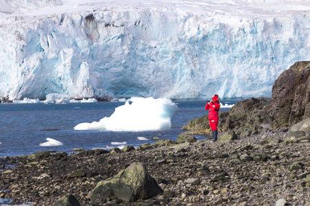 Icebergs landscape. Extreme travelling, Antarctica ice landscape with woman Reklamní fotografie