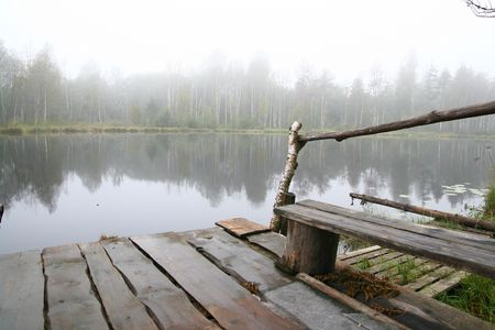 Morning lake in a fog planked footway landscape nature photo