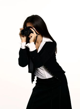 Female photographer taking picture with her camera photo