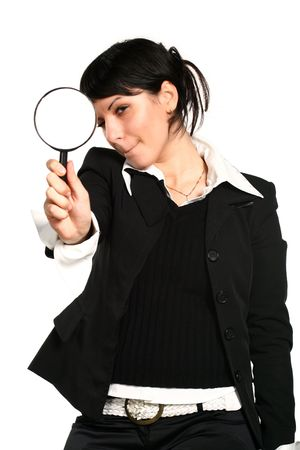 The  girl searches for something through a magnifier  Stock Photo - 2143597