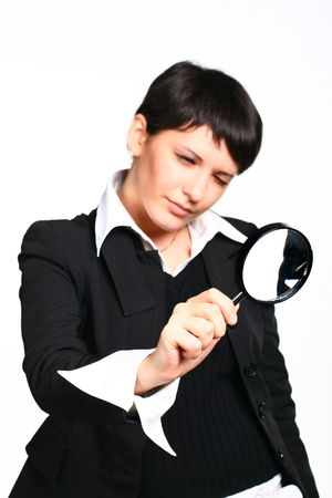The business girl searches for something through a magnifier photo